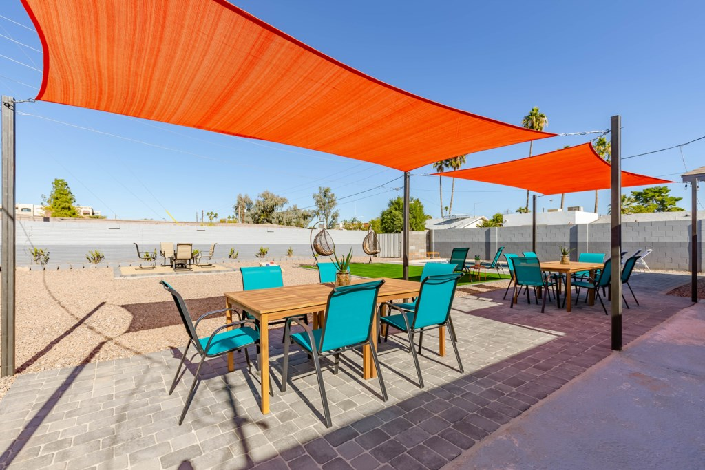 Full access to outdoor dining for any group size, multiple pool loungers and fire pit