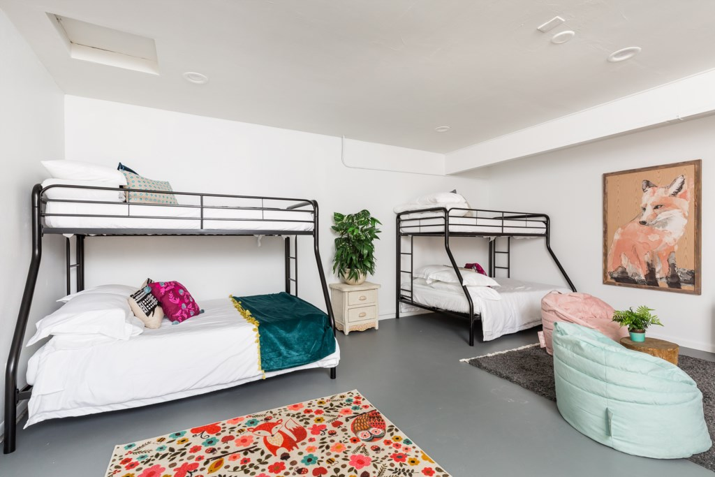 5th Bedroom - 2 twins, 2 double beds (bunks) with flat screen TV and extra seating areas