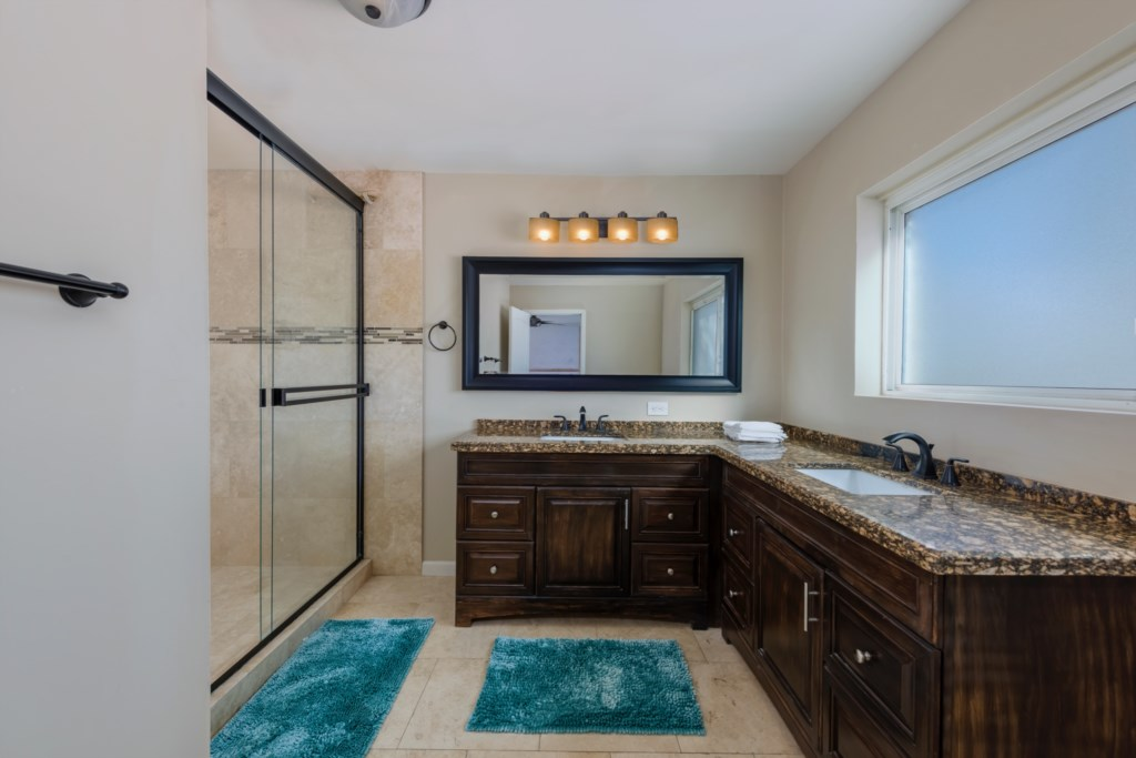 Large master bathroom with double sink vanity and shower