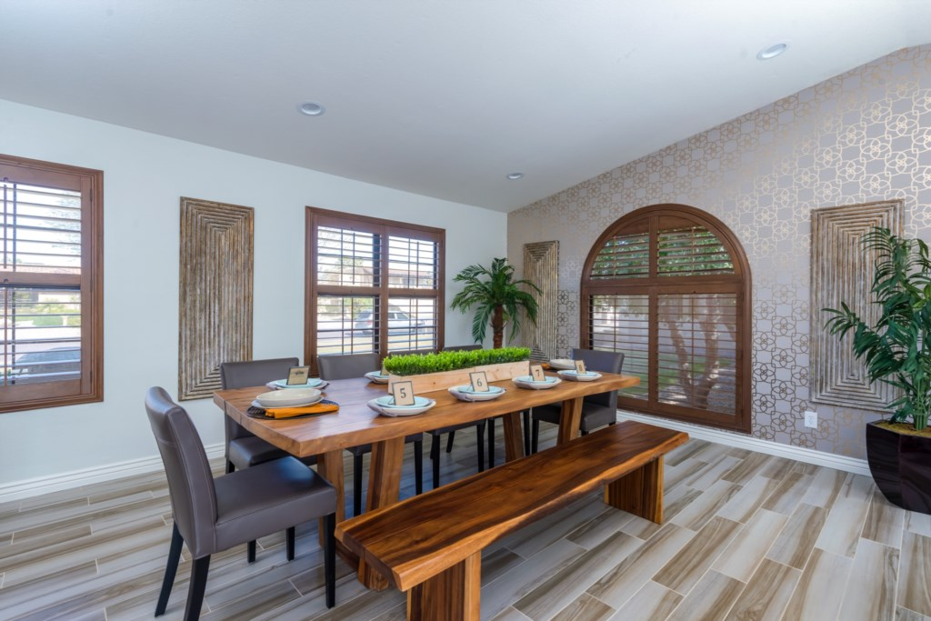 Large open layout with custom wall treatments and finishes