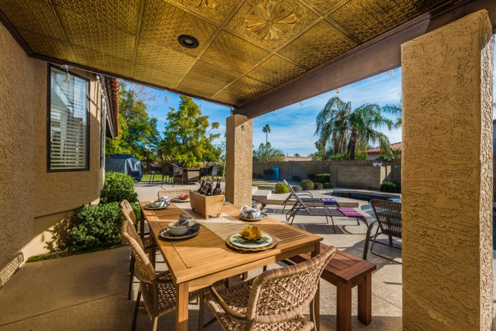 Amazing patio and backyard with outdoor seating, BBQ Grill and Fire Pit!