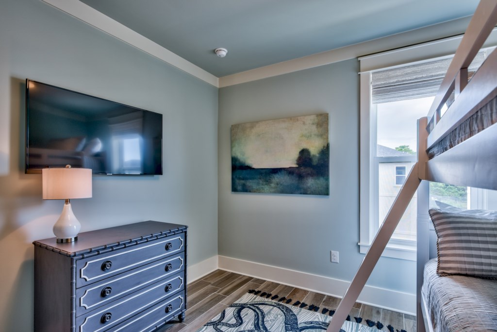 Ample storage and TV in Bunk Bedroom