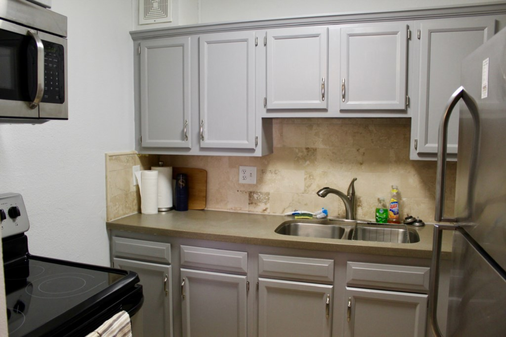 Complete kitchen with a stove, microwave, coffee maker, and full size refrigerator and freezer!