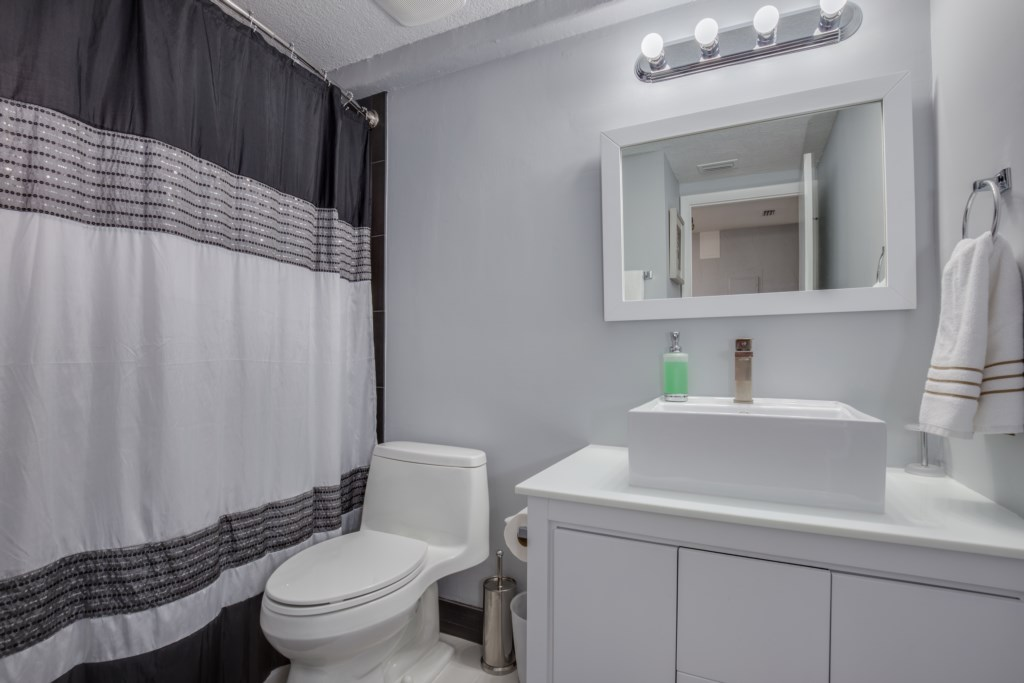 Clean & Sanitized White Bathroom