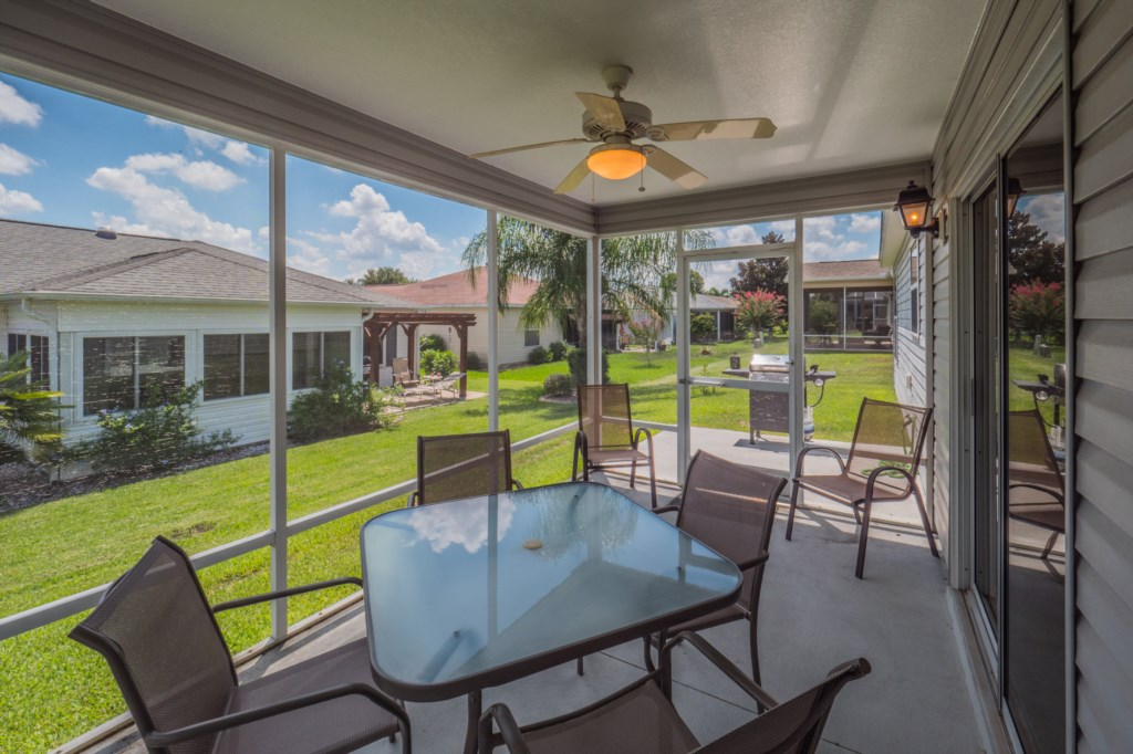 Screened in patio with ceiling fan to enjoy the Florida Breeze