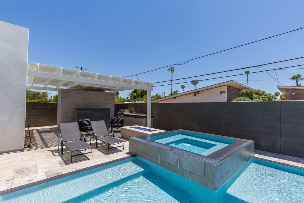 Private backyard pool and hot tub