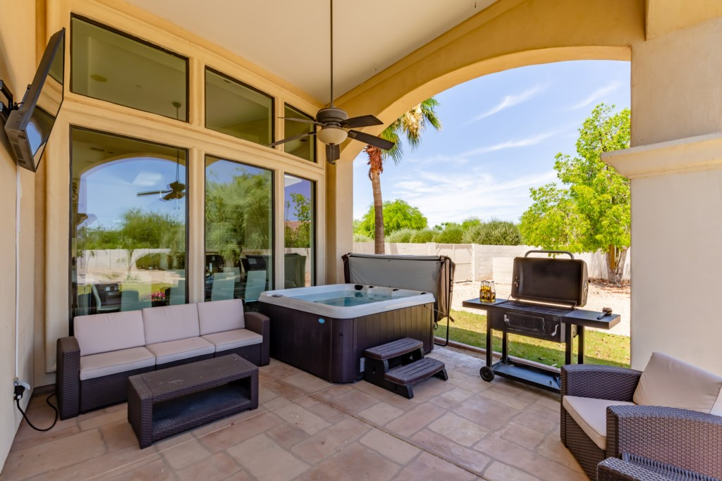 Resort backyard with private pool, Hot tub, Ping Pong table, putting green and outdoor dining!