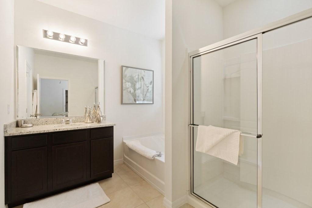 12 En-suite with bath & double shower