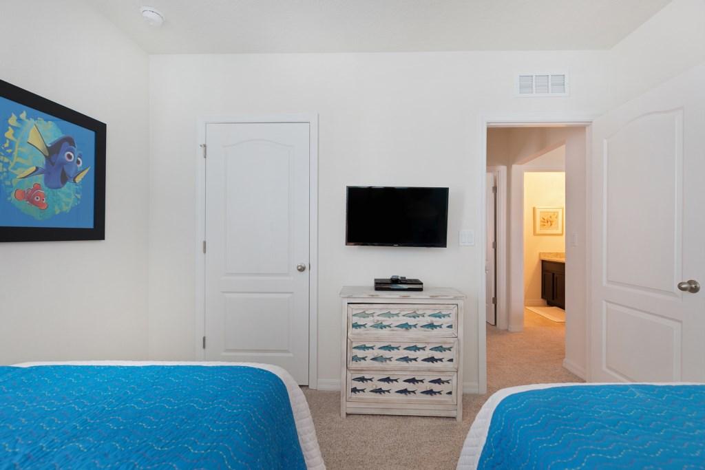 17 Twin bedroom TV