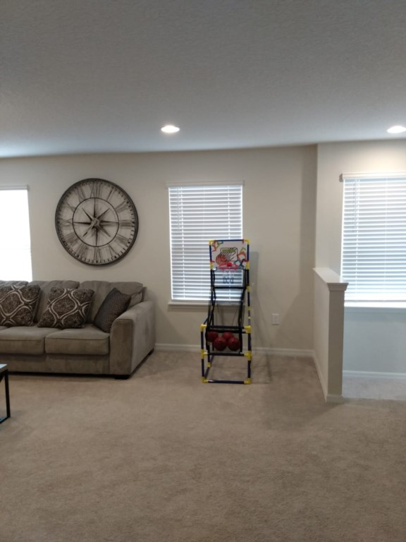 View 5  of entertainment room with basketball game, air hockey, and flat screen TV
