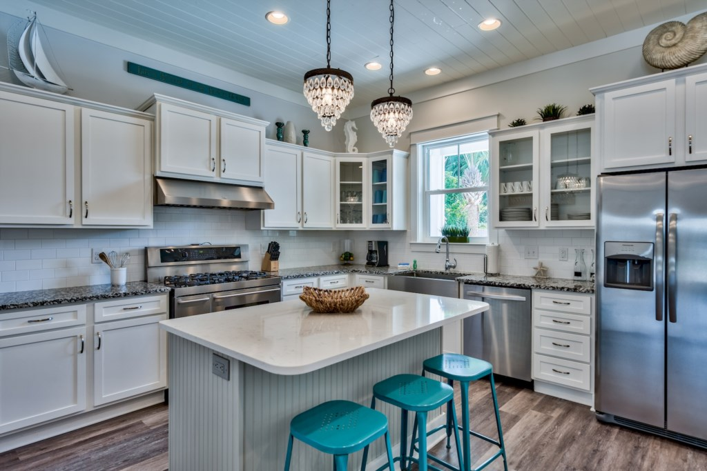 Custom Cabinetry, Quartz counters are just a few of the high end features