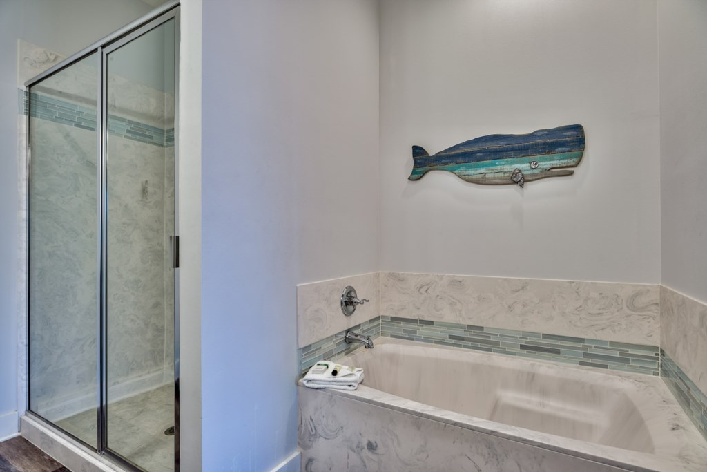 Wash away the aches of the day in your soaker tub or walk-in shower