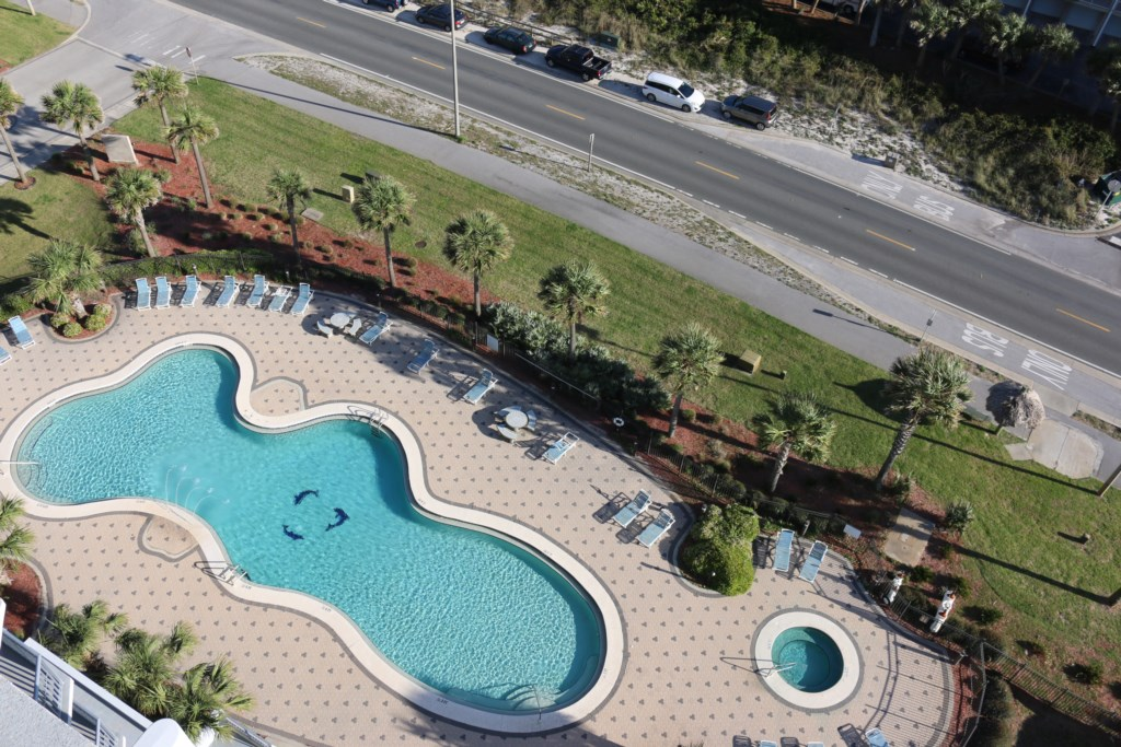 View of the community pool and spa from balcony