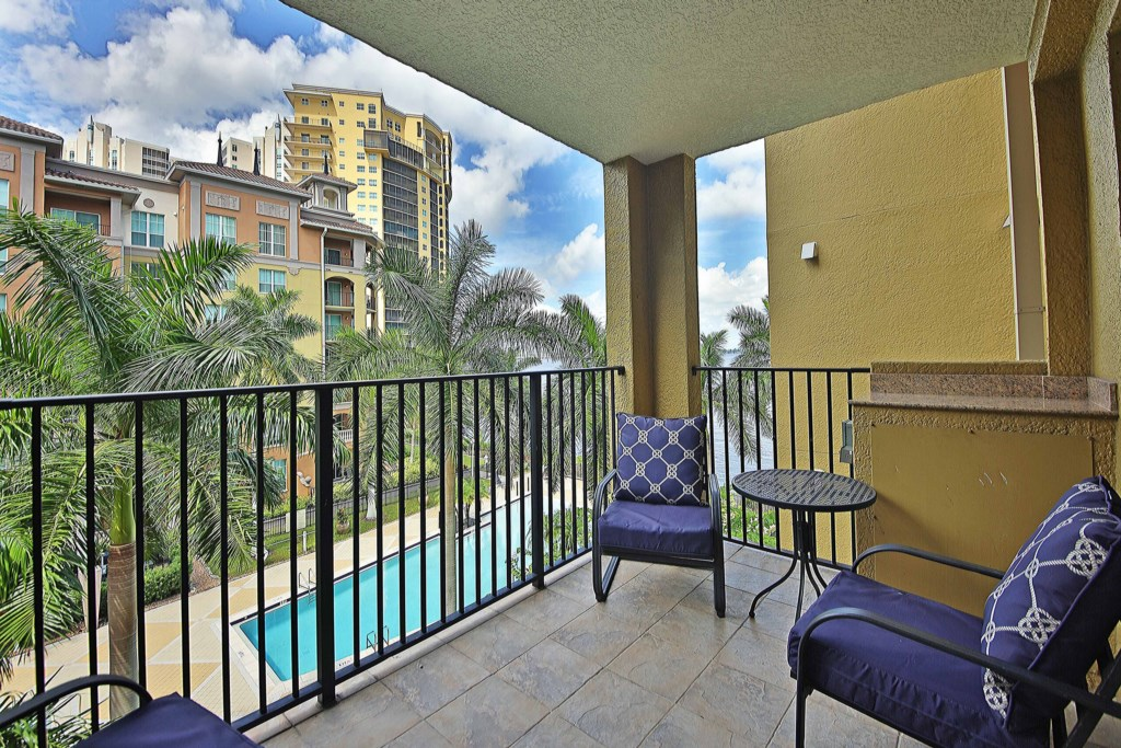 Relax on your large Patio with views of the Pool area