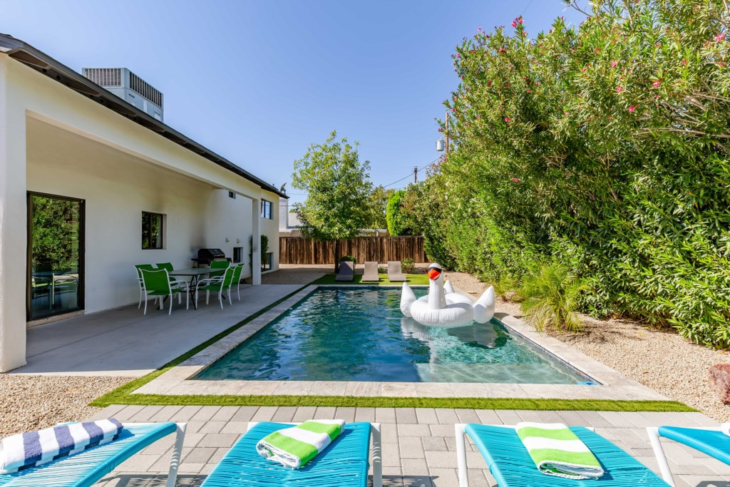 Private outdoor area with pool and outdoor games