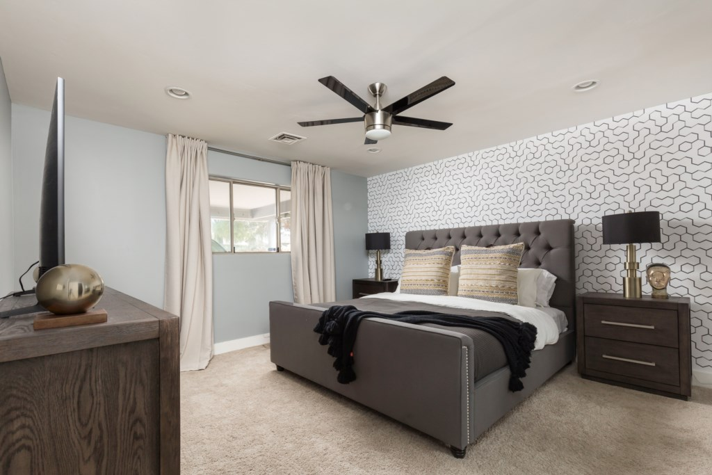 Master Bedroom with King bed, large flat screen and en-suite bathroom
