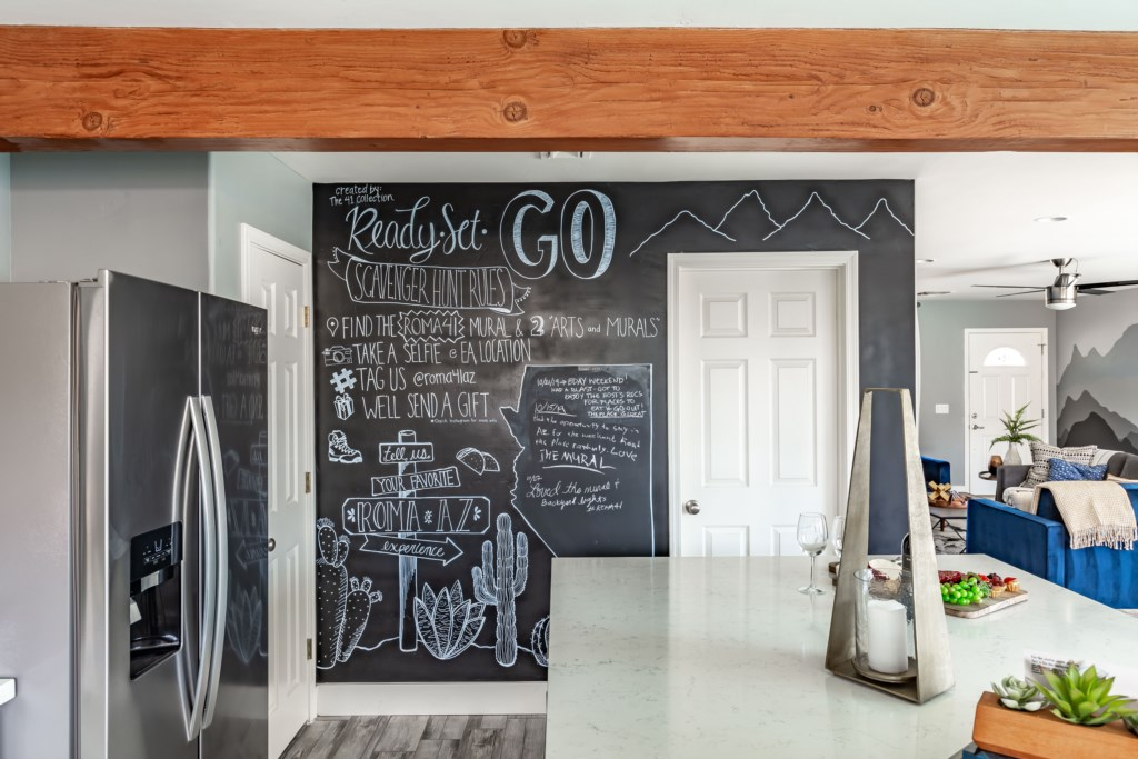 Chalk wall to write your guest experience!