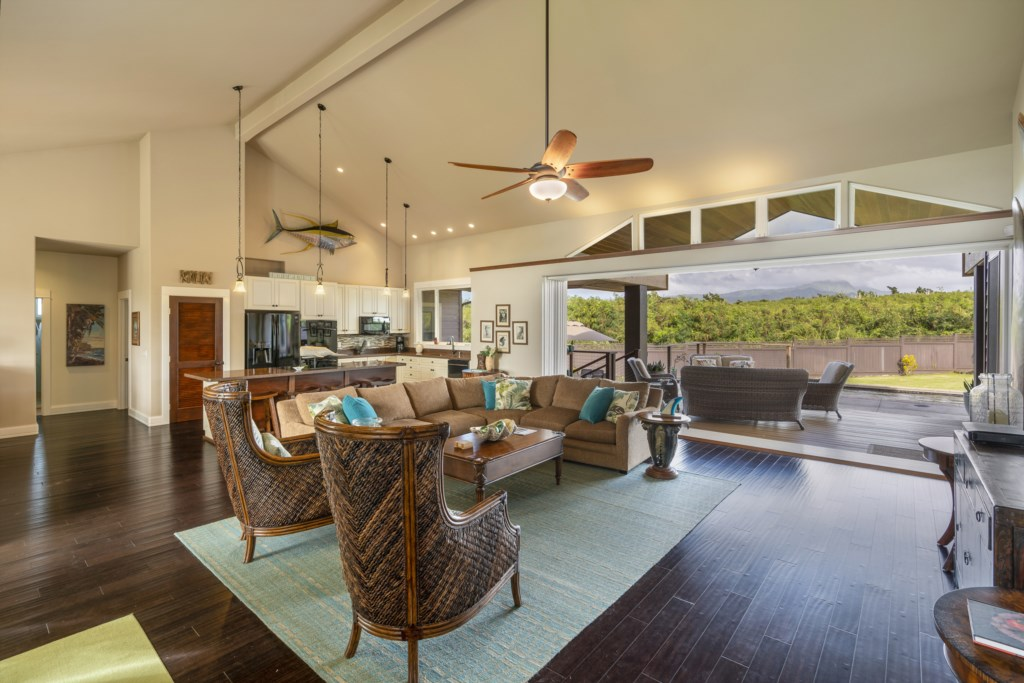 Spectacular living room view where you can also view the backyard pool & seating area