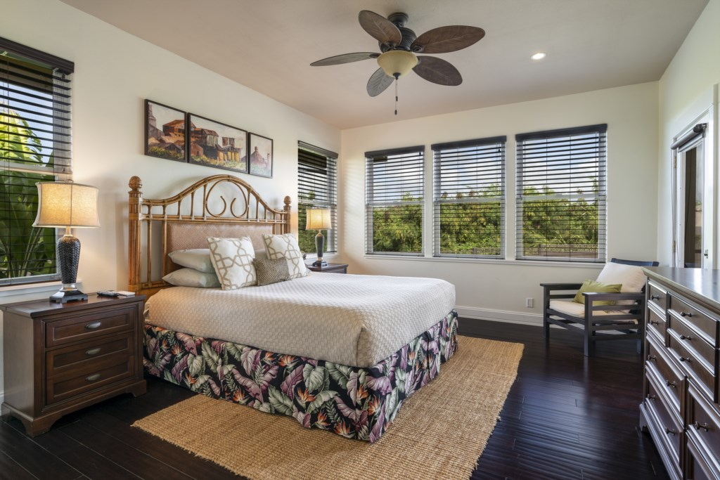 Enjoy your evening in this spacious bedroom with ceiling fan & great view