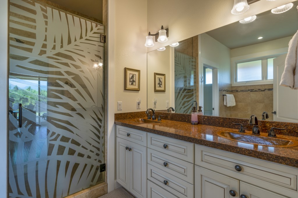Large bathroom with his/her sink and walk-in shower