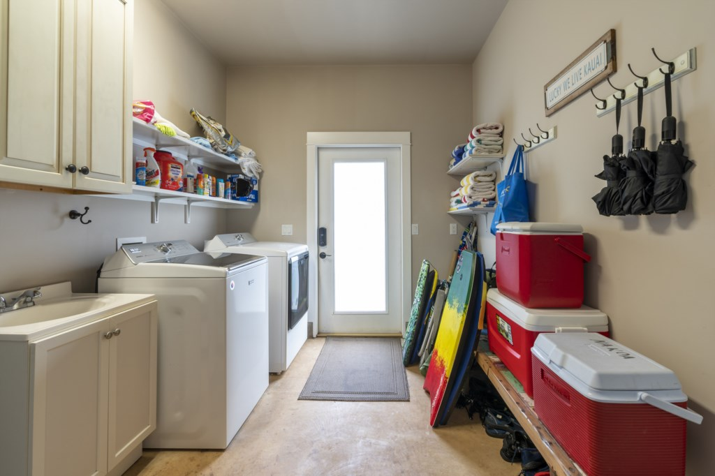 Large laundry room with sink and cabinet space