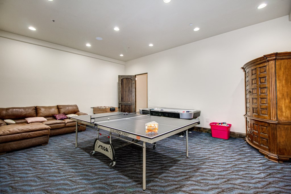 Game room with air hockey, ping ping and more!