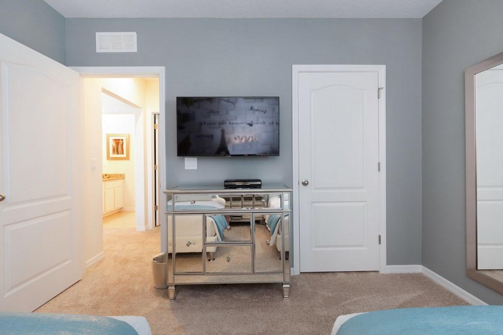 24 Twin bedroom TV