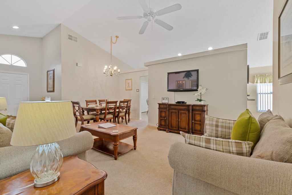 A spacious living room next to the Dining area