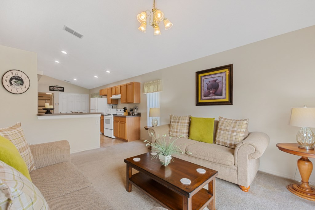 A spacious living room next to the Kitchen