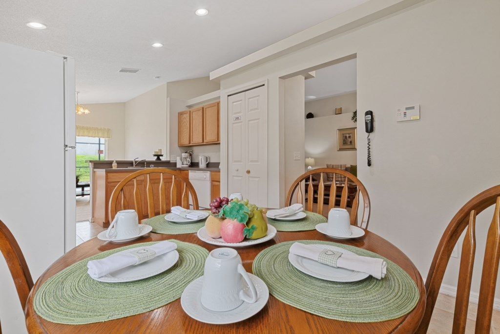 Dining table next to a beautiful kitchen
