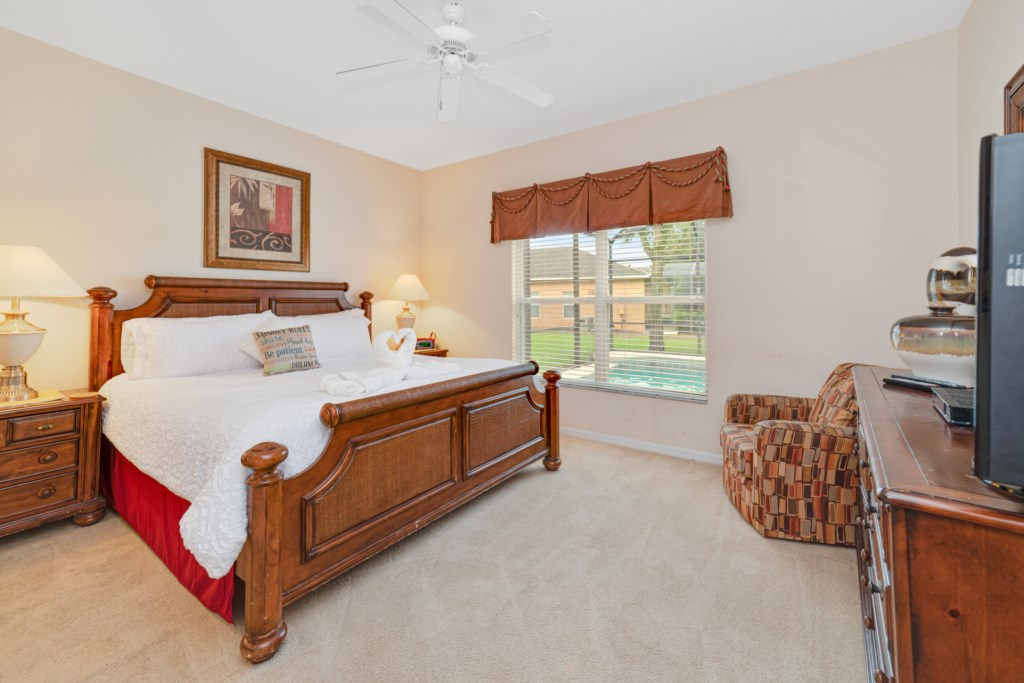 Master's bedroom with a king size bed