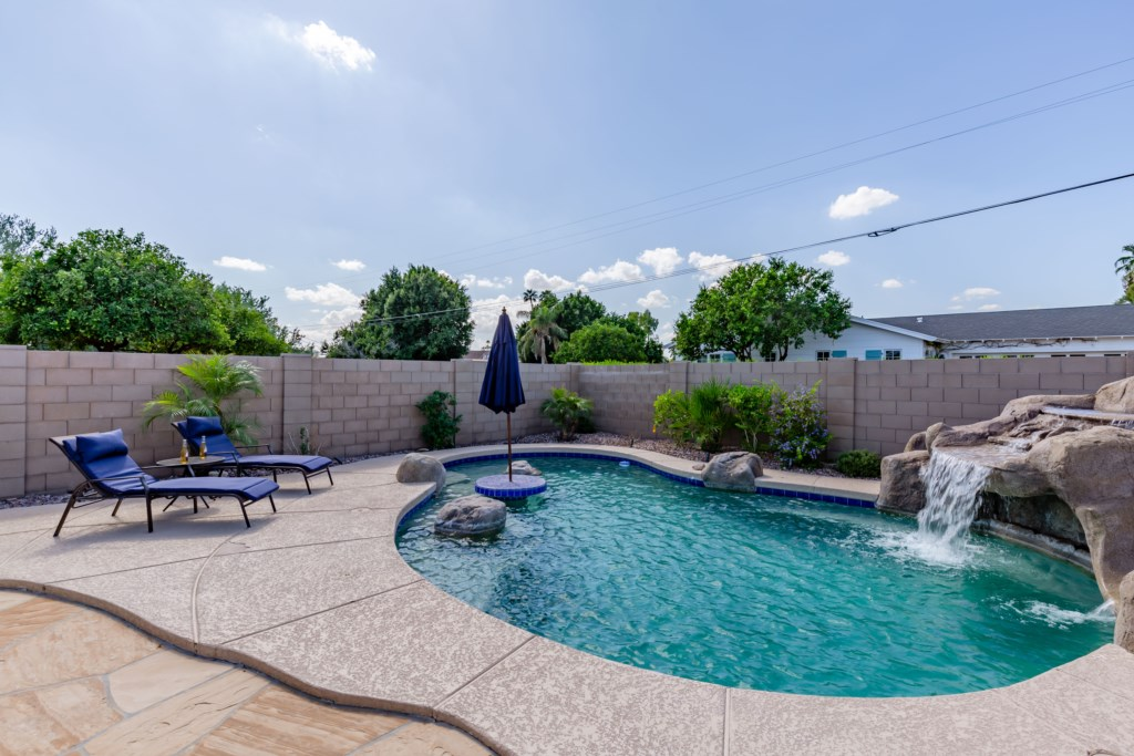 Amazing backyard with private pool with waterfall, BBQ grill, TV and dining
