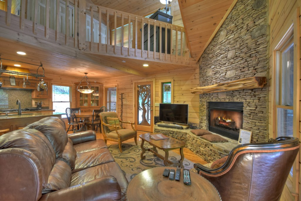Relax in front of your stone fireplace in this tranquil sitting area