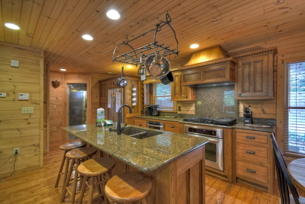 You will love cooking in the gourmet kitchen whilist your guests can sit with you around the island
