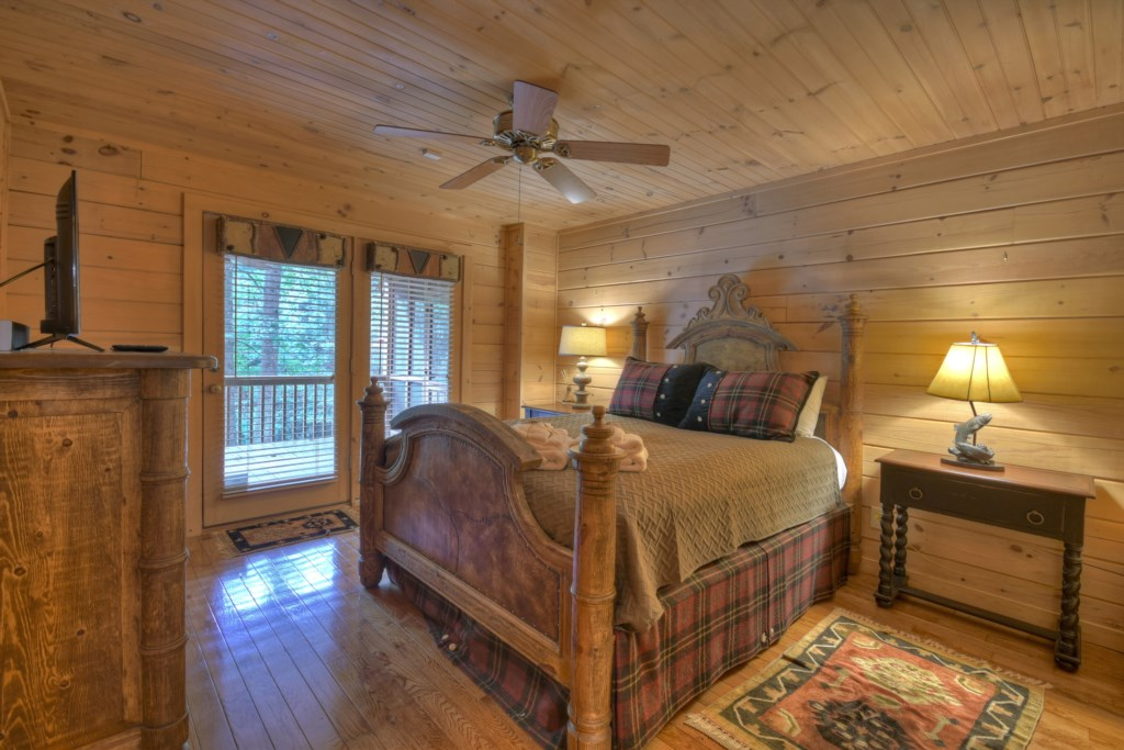 Spacious bedroom with ceiling fan and access to the porch