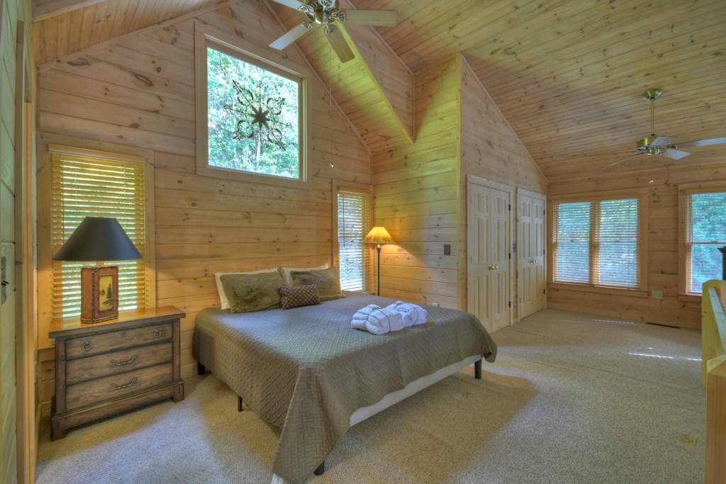Large spacious bedroom with vaulted ceiling