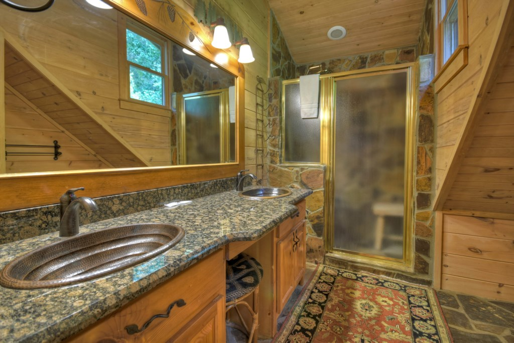 Large bathroom with double vanity and walk-in shower