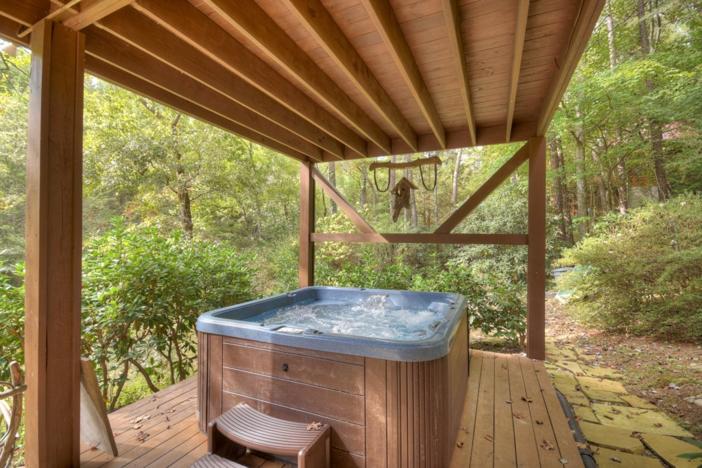 Soak in the Hot Tub and take in the woodland views