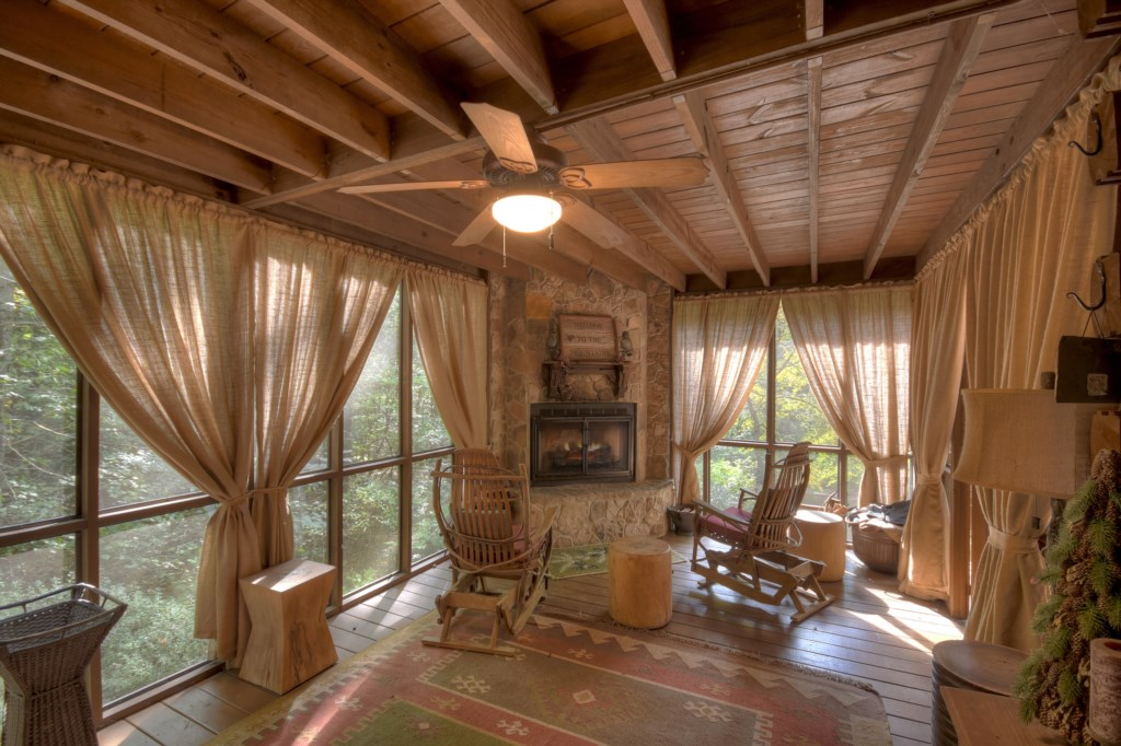 Enjoy the views from your own treehouse in this amazing sunroom