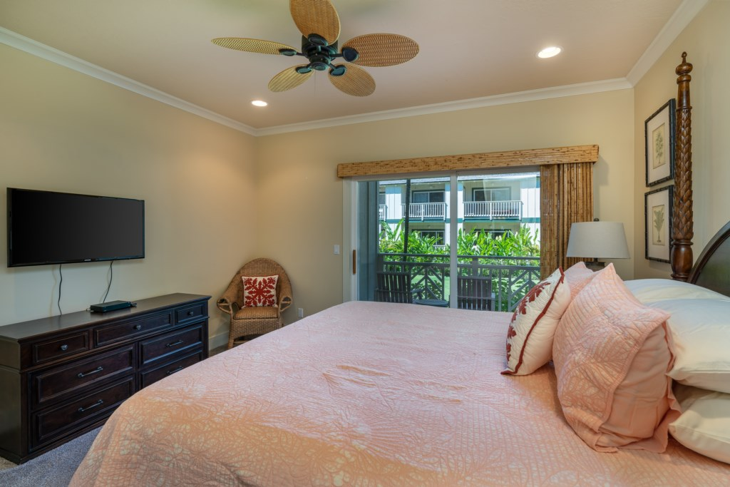 Cozy King bedroom with ceiling fan