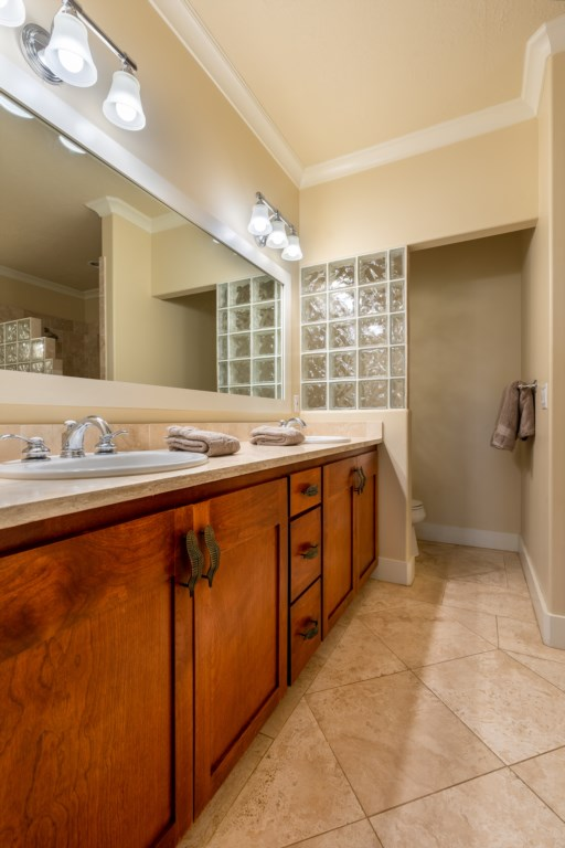 Full bathroom with his/her sink with great lighting