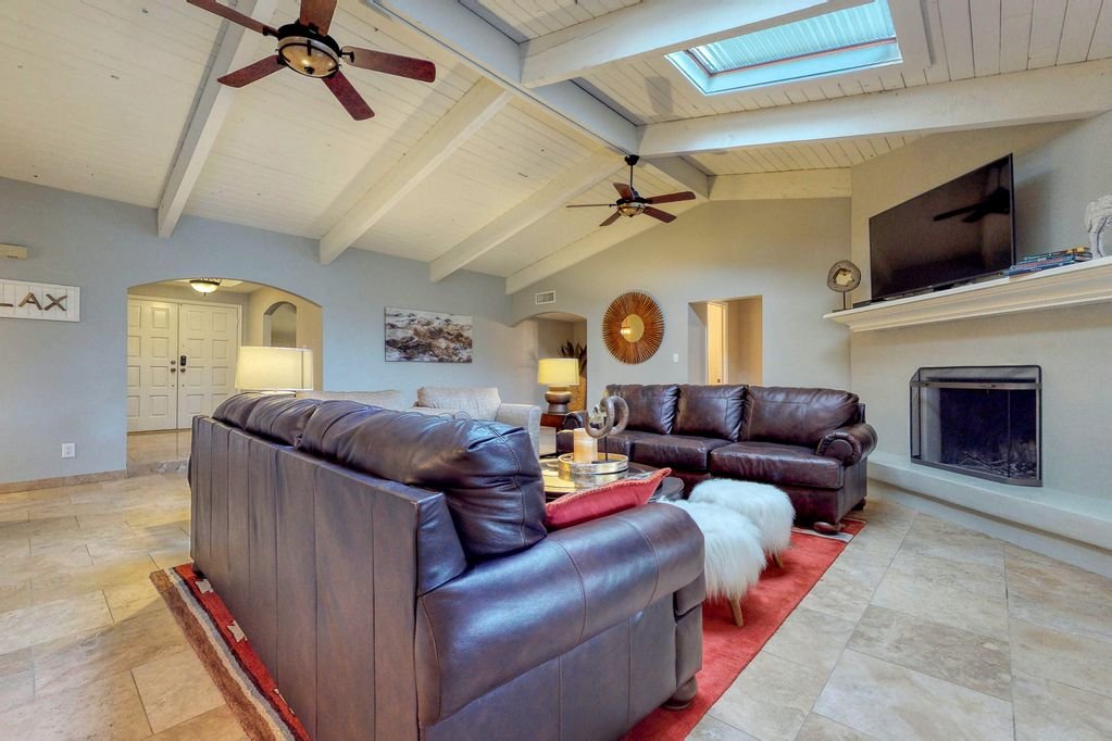 Bright open living room with vaulted ceilings