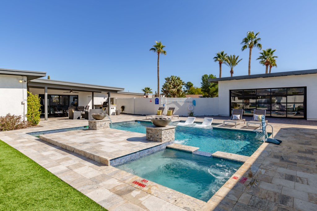 Private backyard with amazing pool and hot tub