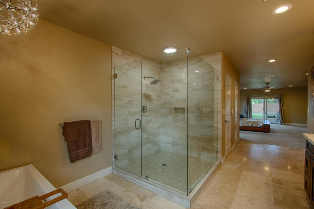 Master bathroom with huge walk in shower, stand alone soaking tub and double sink vanity
