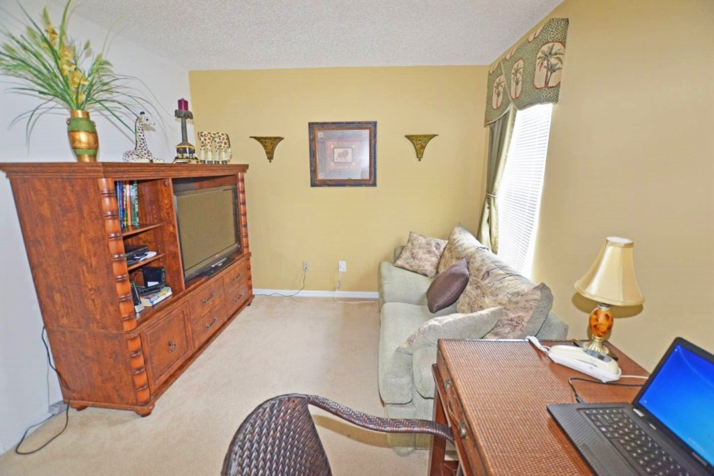 Upstairs den with sofa bed, flat screen cable-TV and desk with laptop.jpg