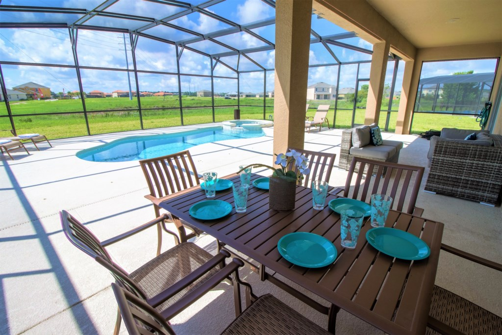 2. Shaded dining area outside is perfect for a BBQ.jpg