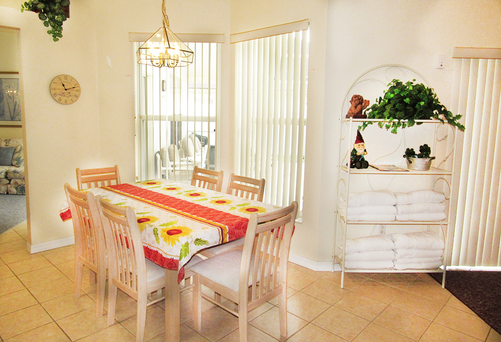 Kitchen dining room. Plenty of seating for all guests between the 2 x dining areas.