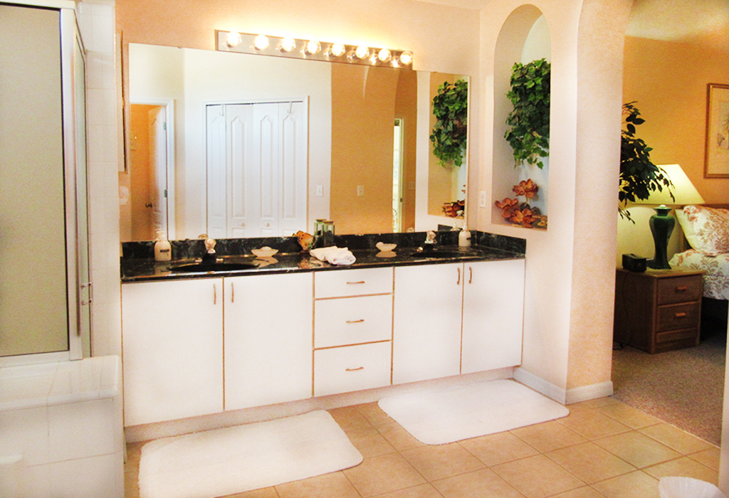 Spacious Master bathroom with dual sinks, walk-in shower, and bathtub.