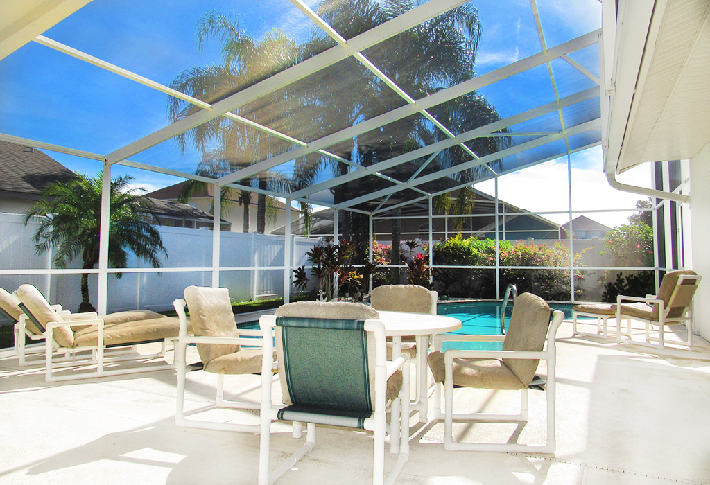 Comfortable outdoor dining area for you to cool off under the lanai.