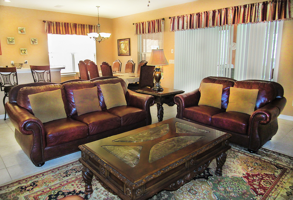 Family room with comfortable leather couches, large screen TV and all open plan.